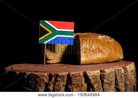 South African Flag On A Stump With Bread Isolated