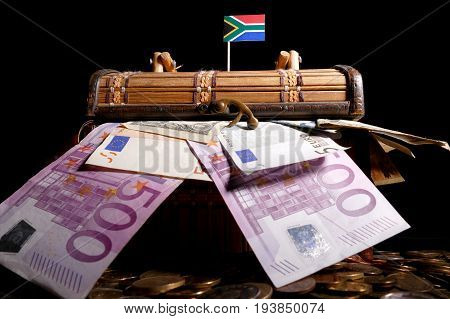 South African Flag On Top Of Crate Full Of Money