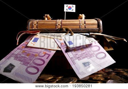 South Korean Flag On Top Of Crate Full Of Money