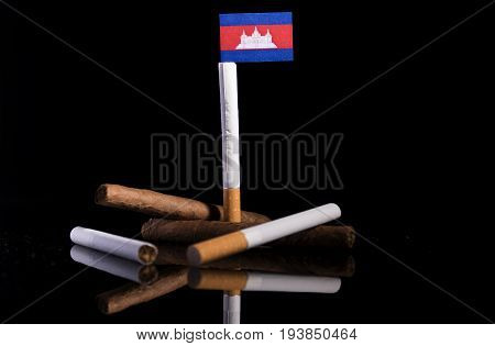 Cambodian Flag With Cigarettes And Cigars. Tobacco Industry Concept.