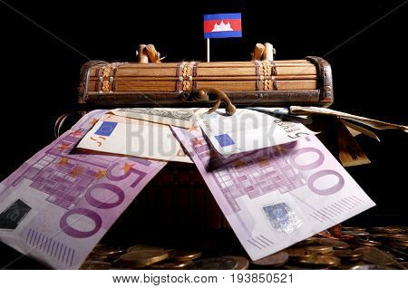 Cambodian Flag On Top Of Crate Full Of Money