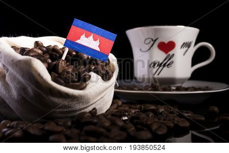 Cambodian Flag In A Bag With Coffee Beans Isolated On Black Background