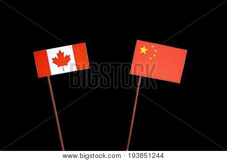 Canadian Flag With Chinese Flag Isolated On Black Background