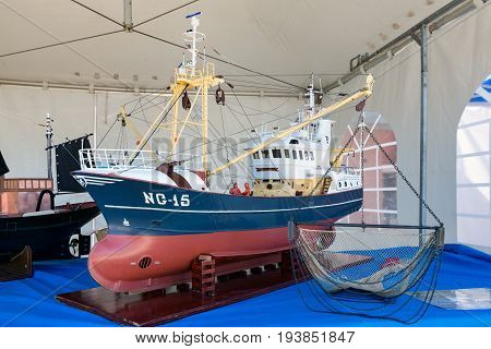 URK THE NETHERLANDS - MAY 27 2017: Scale model of fishing vessel at harbor of Urk during a local fishing day event