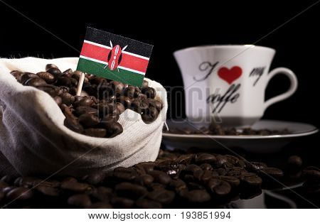 Kenyan Flag In A Bag With Coffee Beans Isolated On Black Background
