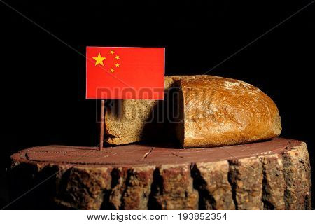 Chinese Flag On A Stump With Bread Isolated