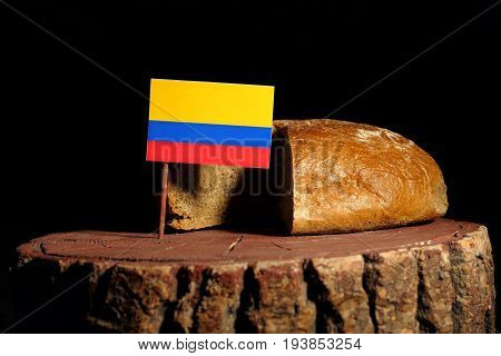 Colombian Flag On A Stump With Bread Isolated