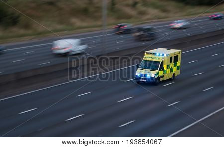 Watford UK - July 2 2017: Ambulance in rush on the British motorway M1
