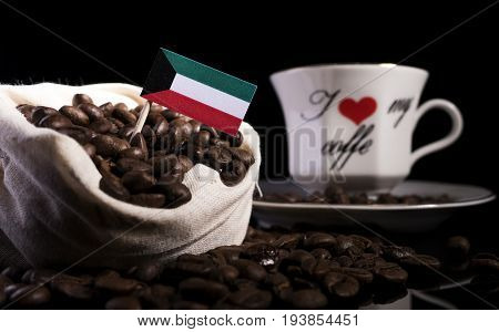 Kuwaiti Flag In A Bag With Coffee Beans Isolated On Black Background