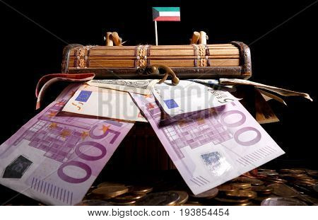Kuwaiti Flag On Top Of Crate Full Of Money
