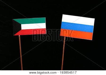 Kuwaiti Flag With Russian Flag Isolated On Black Background