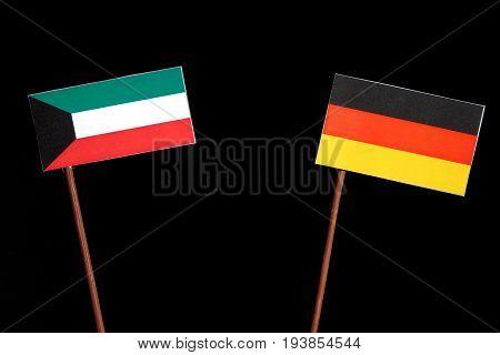 Kuwaiti Flag With German Flag Isolated On Black Background