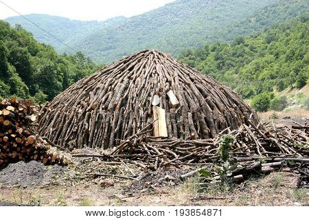 Production of charcoal for braziers and a barbecue. 1 stage - preparation of firewood