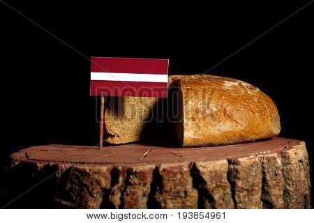 Latvia Flag On A Stump With Bread Isolated