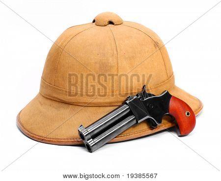 Necessary articles for bushmens. Tropical cork helmet and 2 shot .45 cal derringer hand gun.