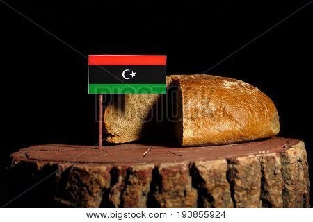 Libyan Flag On A Stump With Bread Isolated
