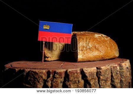 Liechtenstein Flag On A Stump With Bread Isolated