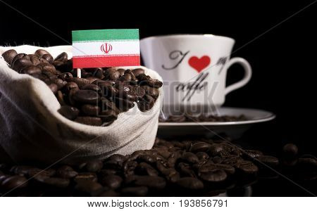 Iranian Flag In A Bag With Coffee Beans Isolated On Black Background