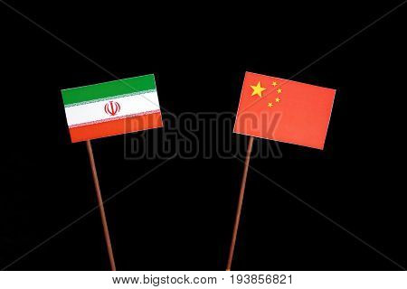 Iranian Flag With Chinese Flag Isolated On Black Background