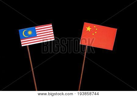 Malaysian Flag With Chinese Flag Isolated On Black Background