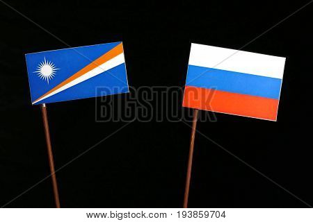 Marshall Islands Flag With Russian Flag Isolated On Black Background
