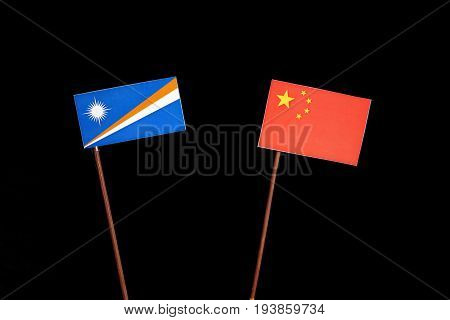 Marshall Islands Flag With Chinese Flag Isolated On Black Background
