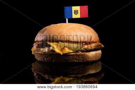Moldovan Flag On Top Of Hamburger Isolated On Black Background
