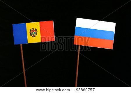 Moldovan Flag With Russian Flag Isolated On Black Background