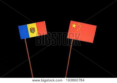 Moldovan Flag With Chinese Flag Isolated On Black Background