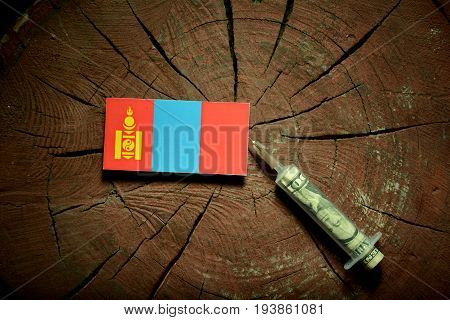 Mongolian Flag On A Stump With Syringe Injecting Money In Flag