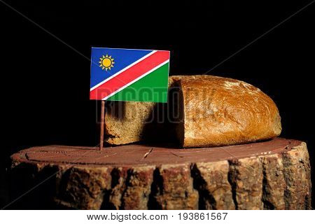 Namibian Flag On A Stump With Bread Isolated