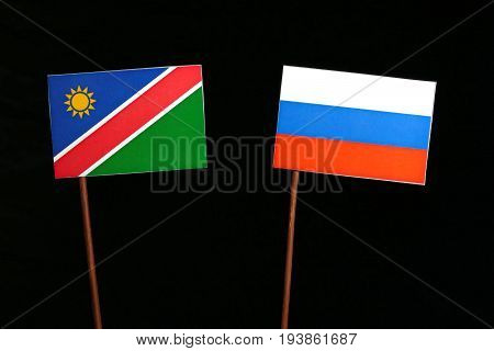 Namibian Flag With Russian Flag Isolated On Black Background