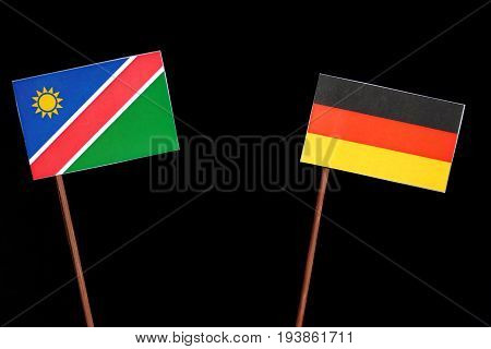 Namibian Flag With German Flag Isolated On Black Background