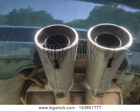 Double exhaust pipes from a car. Underside view
