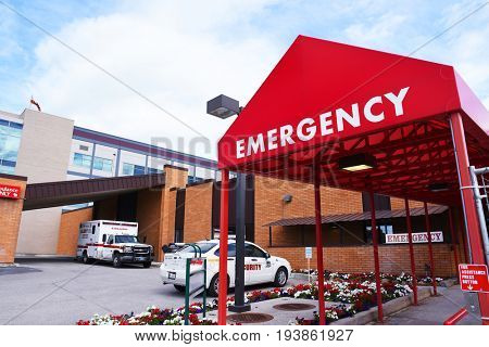 KALISPELL, MONTANA, USA - June 19, 2017: Emergency room entrance at Kalispell Regional Medical Center with an ambulance and security car in the background