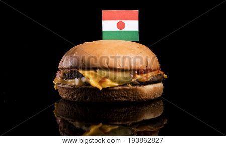 Niger Flag On Top Of Hamburger Isolated On Black Background