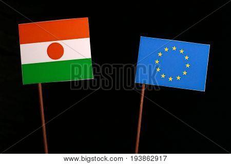 Niger Flag With European Union (eu) Flag Isolated On Black Background