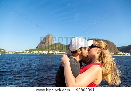 Romantic tourists in front of the Sugarloaf mountain in Rio de Janeiro, Brazil