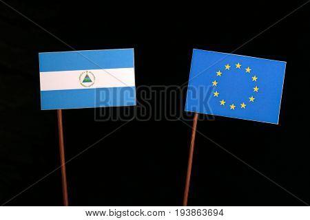Nicaraguan Flag With European Union (eu) Flag Isolated On Black Background