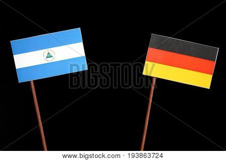 Nicaraguan Flag With German Flag Isolated On Black Background