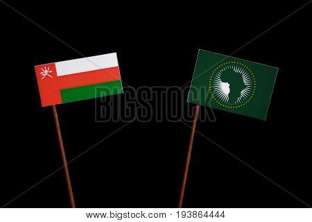 Omani Flag With African Union Flag Isolated On Black Background