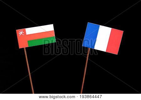 Omani Flag With French Flag Isolated On Black Background