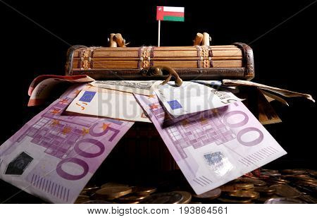 Omani Flag On Top Of Crate Full Of Money