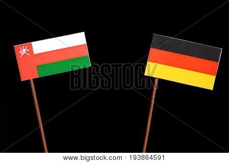 Omani Flag With German Flag Isolated On Black Background