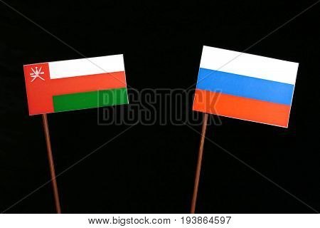 Omani Flag With Russian Flag Isolated On Black Background