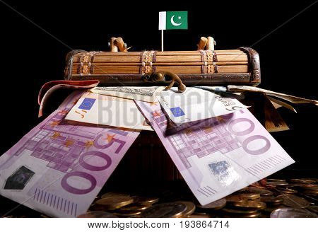 Pakistani Flag On Top Of Crate Full Of Money
