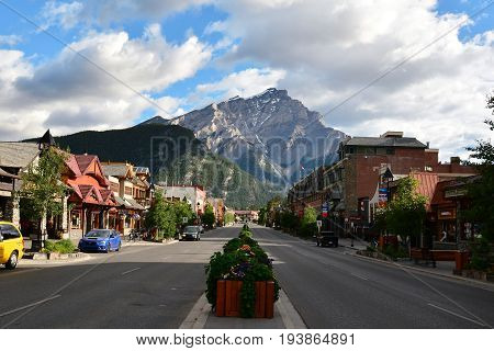 Banff Alberta Canada,July 6th 2014.Main street Banff Alberta with hotels and shops and beautiful Mount Norquay in the background .Come to Banff and create memories.