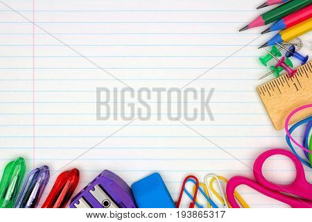 Colorful School Supplies Corner Border Over A Lined Paper Background