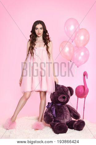 beautiful girl with doll make-up on pink background
