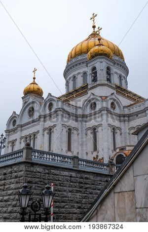 MOSCOW RUSSIA - MAY 29 2017: View of the Christ the Savior Cathedral from the door at metro.It's a Orthodox church with golden domes at Moscow.Famous christian landmark in Russia